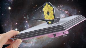 Webb Telescope asy to build paper model held in a hand