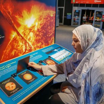 Sun Earth Universe visitors using Sun exhibit flip doors