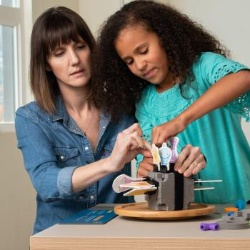 Family working together on a spacecraft model