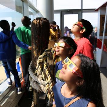 Young learners looking at the solar eclipse