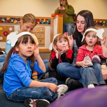 Children listening wearing paper elephant ears in Horton Senses Something Small NanoDays activity