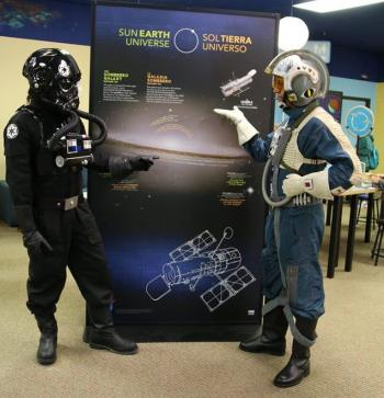 Sun Earth Universe exhibition launch party with people dressed in Star Wars character costumes at Oklahoma Wondertorium in Stillwater Oklahoma
