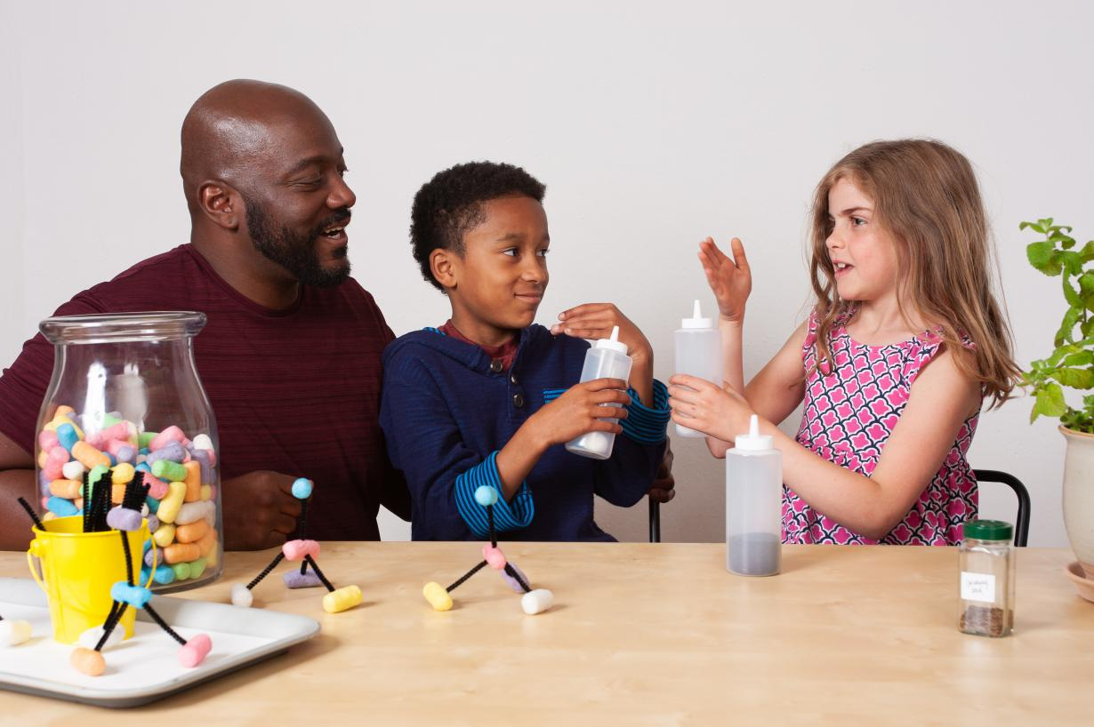 Adult and children sensing and discussing odors in Chemistry Makes Scents activity