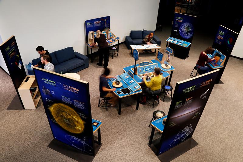 Sun Earth universe exhibition birdseye view