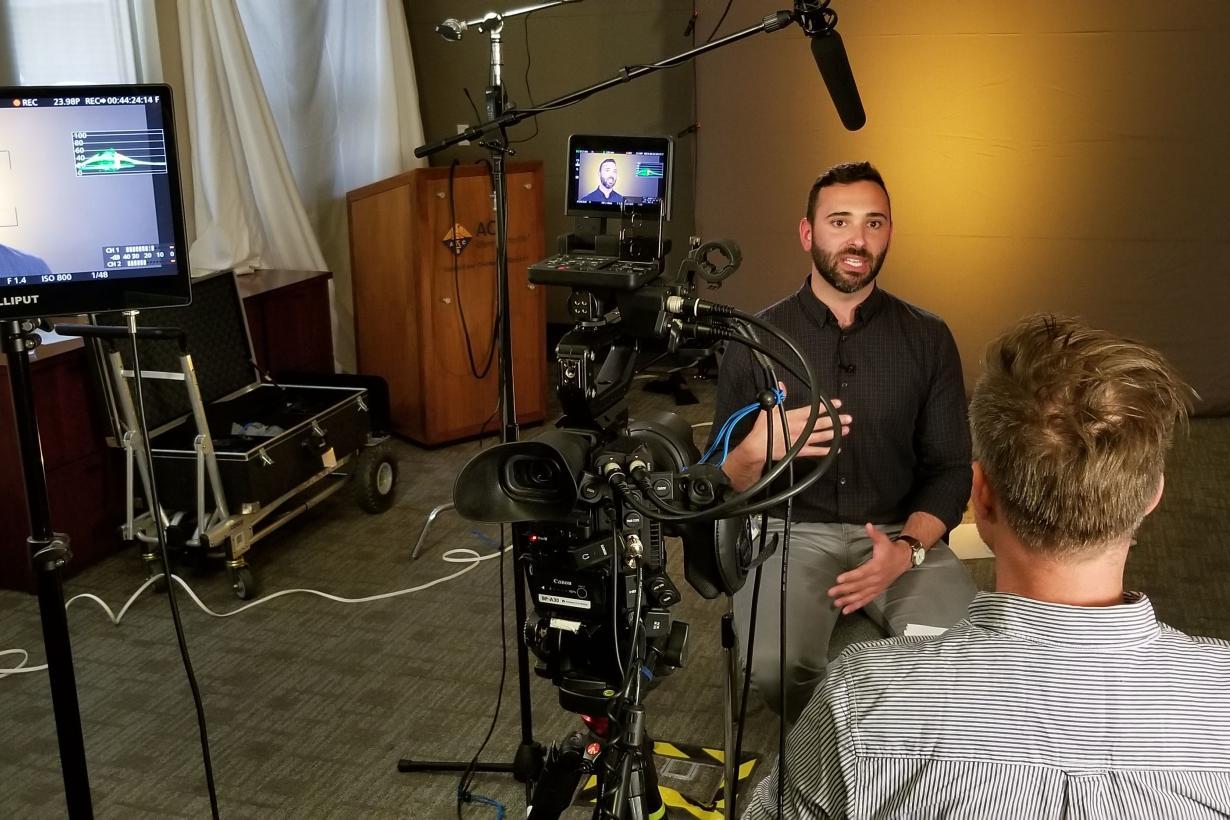 Scientist being interviewed