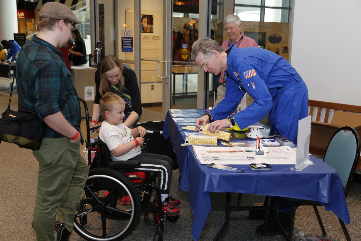 Solar System Ambassador facilitating an activity at an Earth and Space event