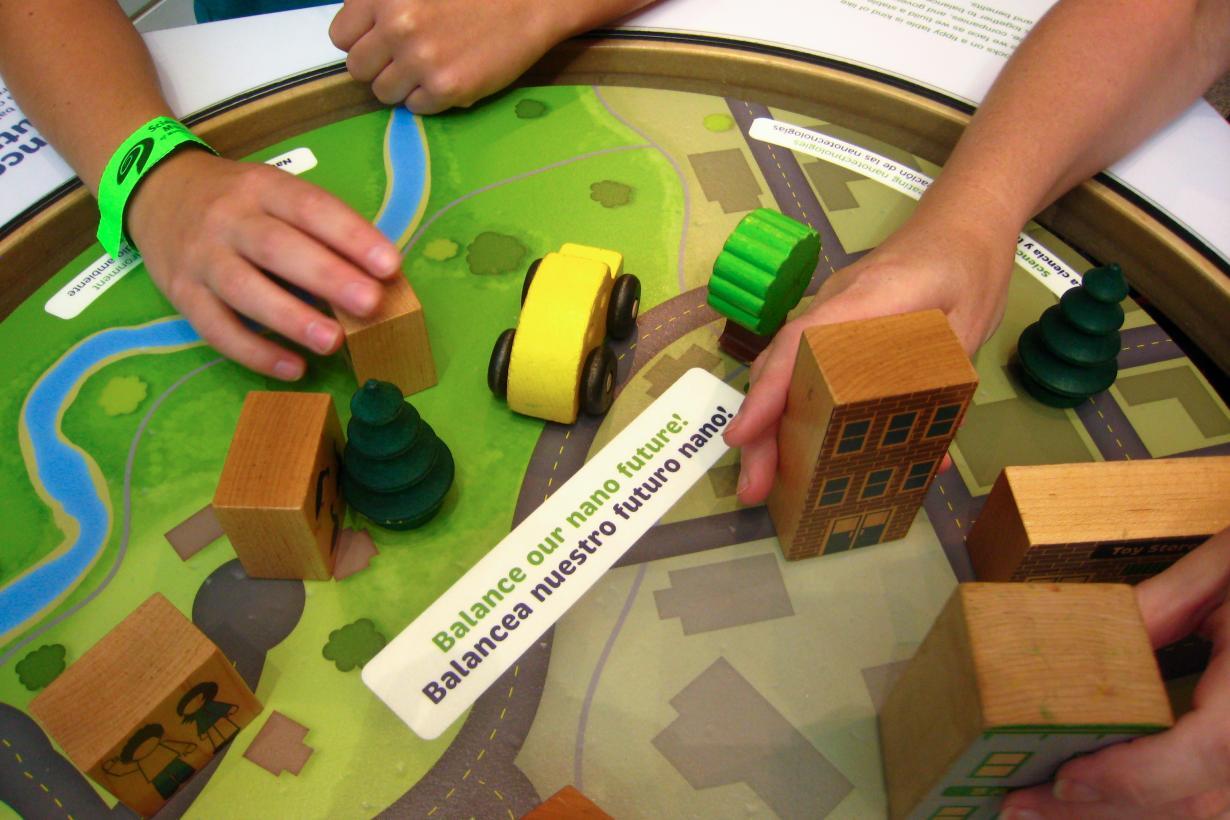 Hands using blocks at balance our nano future exhibit in the Nano exhibition