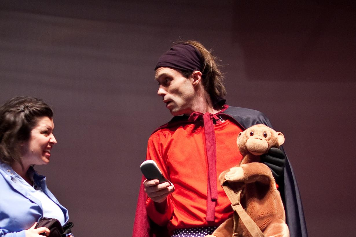 Actors in Attack of the Nanoscientists stage show dressed in superhero outfit with stuffed monkey toy