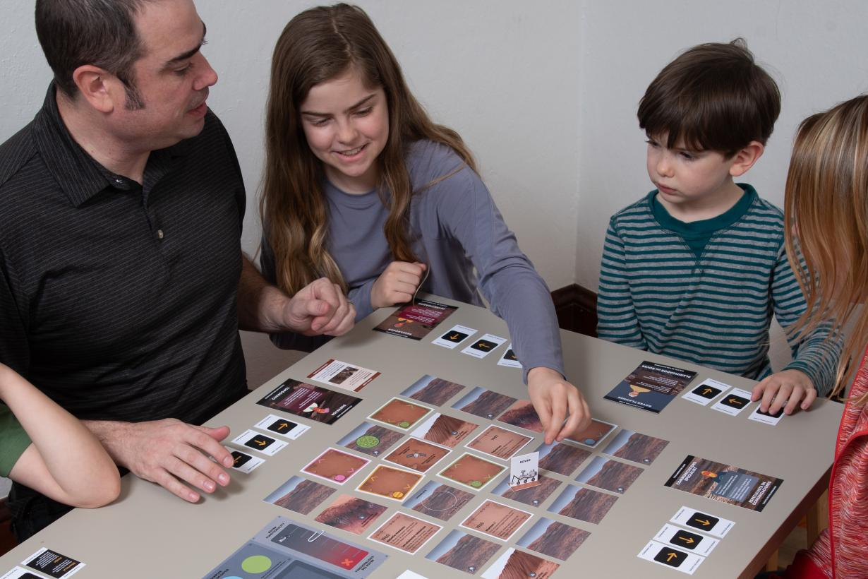 Family playing Explore Mars! A Rover Game board game