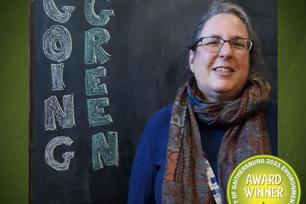 Photo of an Gaithersburg Museum educator accepting a going green award