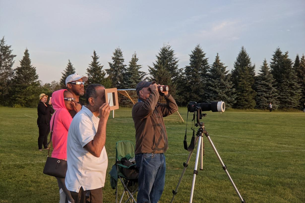Guests at RMSC viewing the 2021 Partial Eclipse