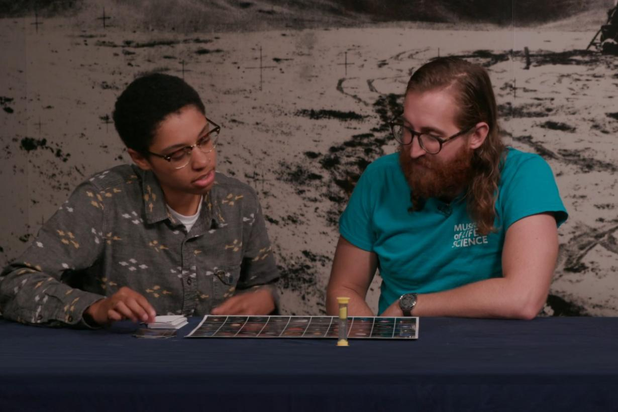 two educators playing space guess quest