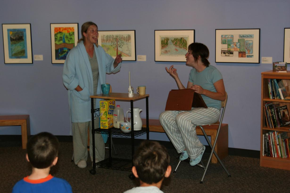 Two actors act in a play about nano and society.