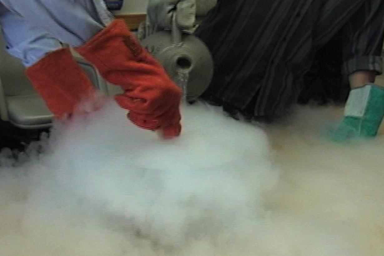 Liquid nitrogen being poured into a vat of cream