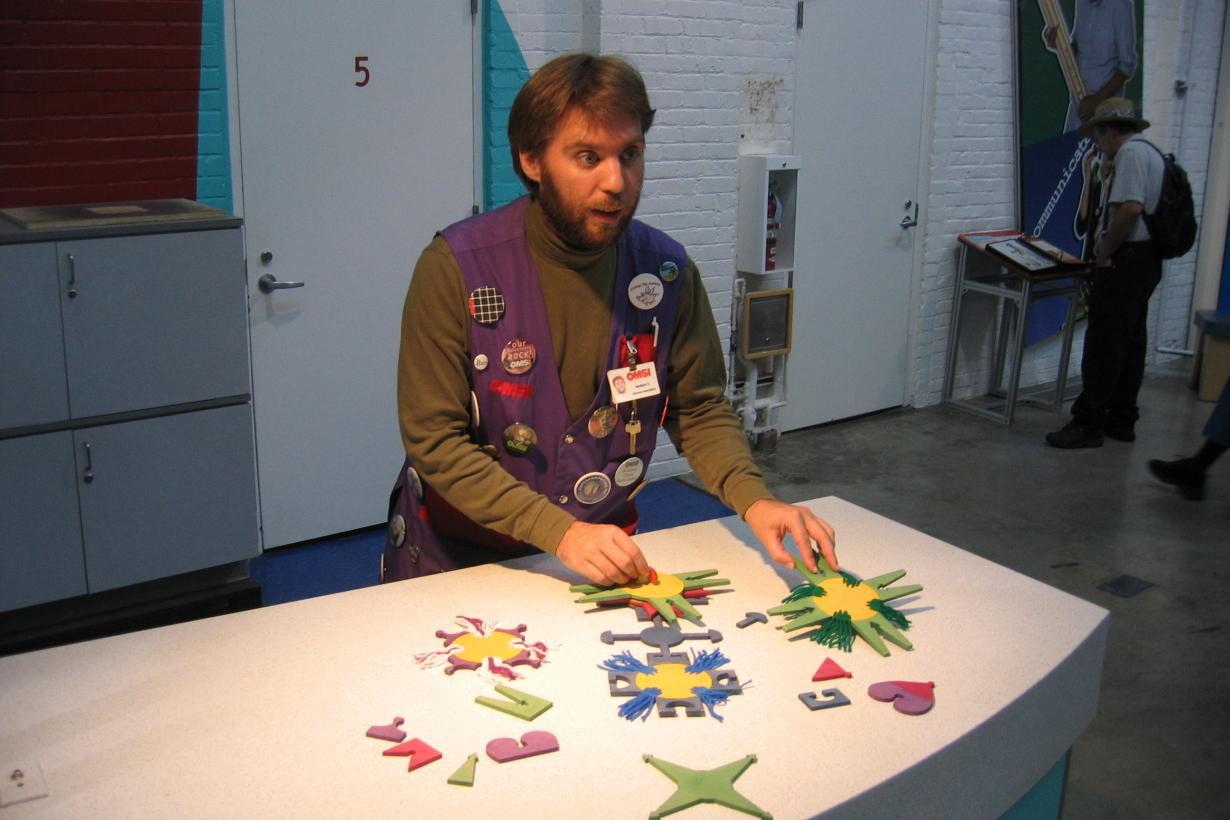 Museum educator demonstrates biobarcodes hands-on activity