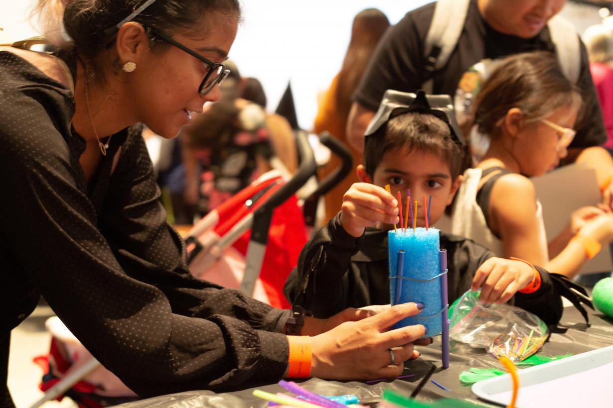 Children and parent using the Scribble Bot drawing activity at the Frankenstein200 event