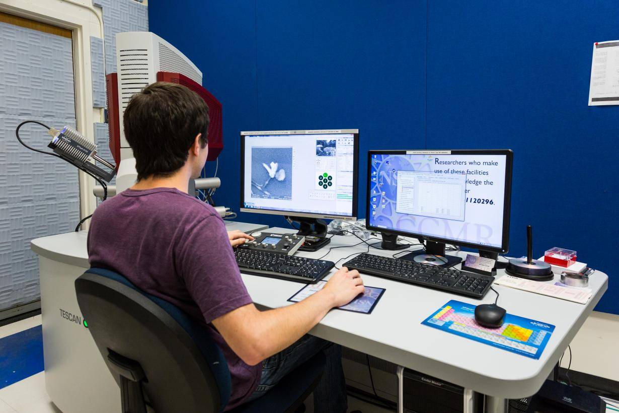Scientific Image - Scientist using a scanning electron microscope