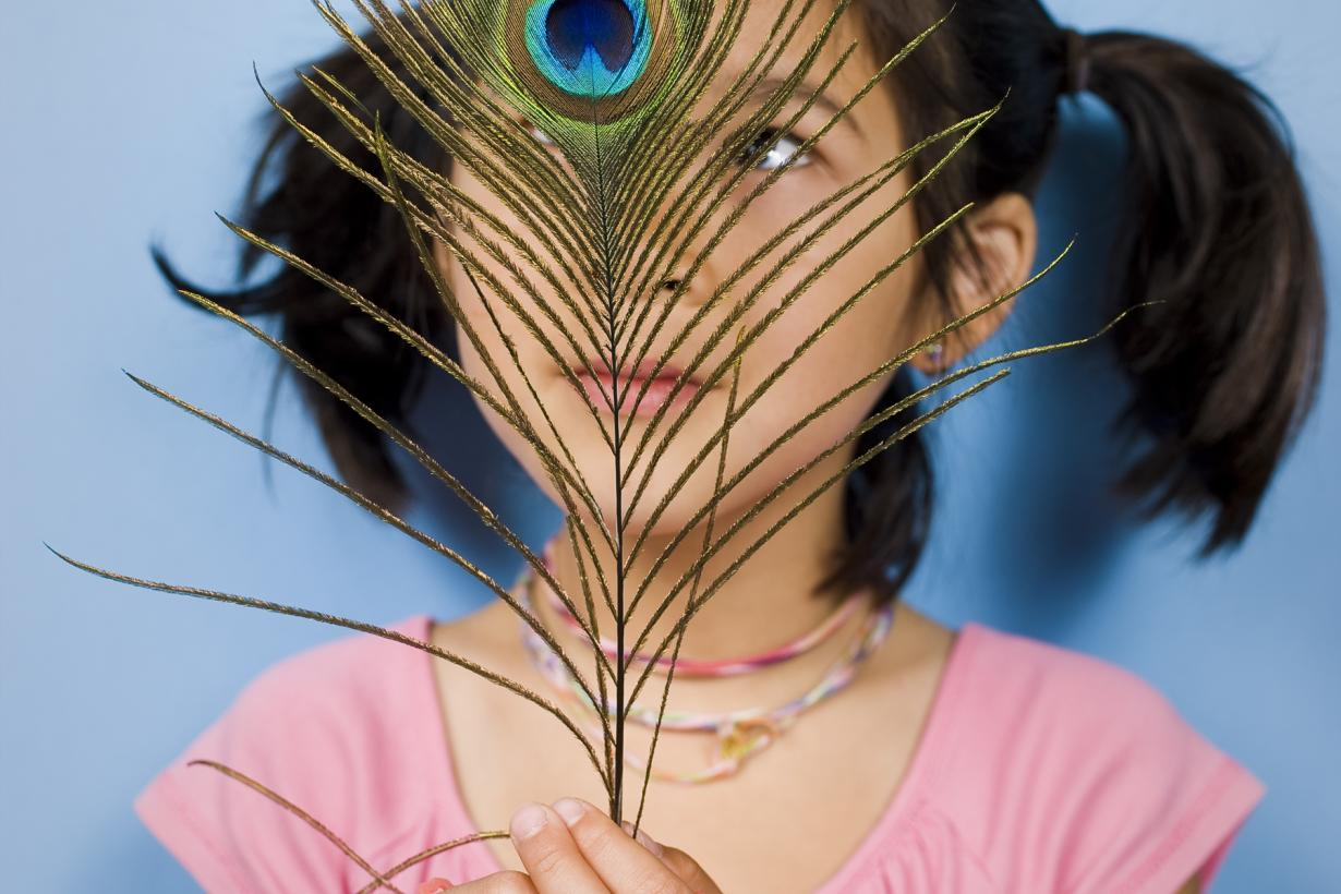 Girl with peacock feather