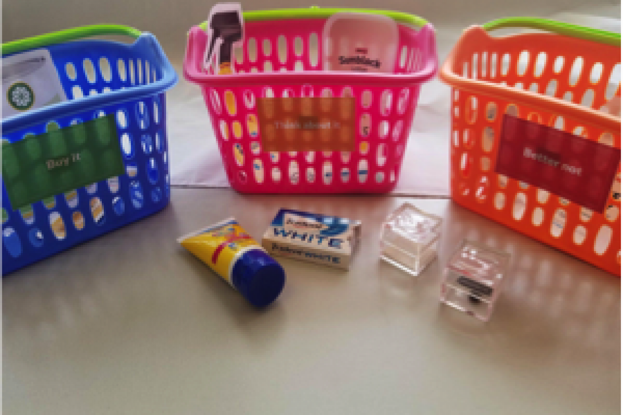 Plastic grocery baskets along with grocery store purchases including sunblock