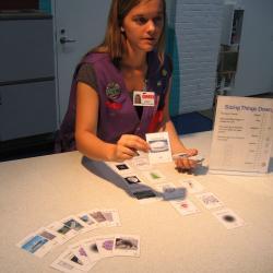 Facilitator with Sizing Things Down card game