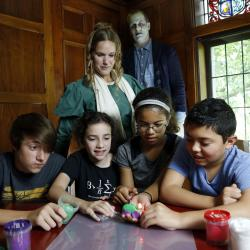 Children and adults using Frankenstein Dough Creature activity - costumed adults dressed as Mary Shelley and Frankenstein monster