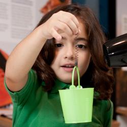 Child exploring properties of metal wire in Exploring Materials—Memory Metal NanDays activity