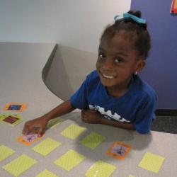 A girl playing the Exploring Size - Memory Game