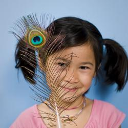 A girl with a peacock feather.