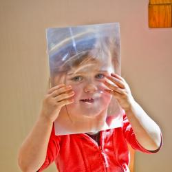 "A young person does a thin film activity related to the story ""Horton Senses Something Small"""