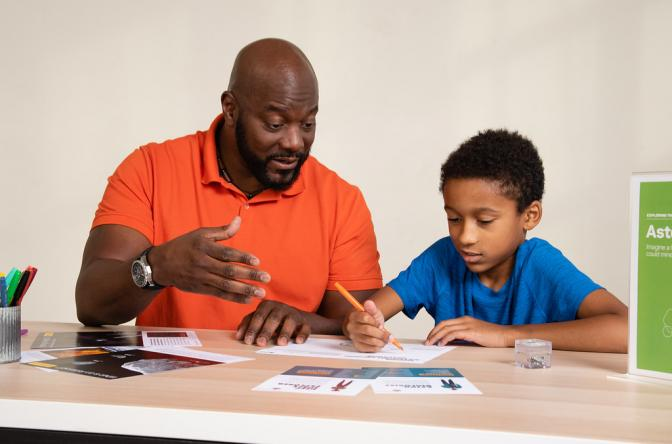 Dad and child talking and creatively drawing using Asteroid Mining Earth and Space activity