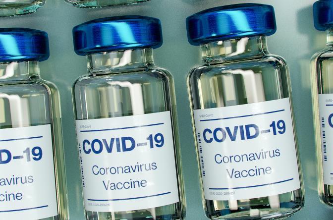 COVID vaccine image credit Daniel Schludi on Unsplash