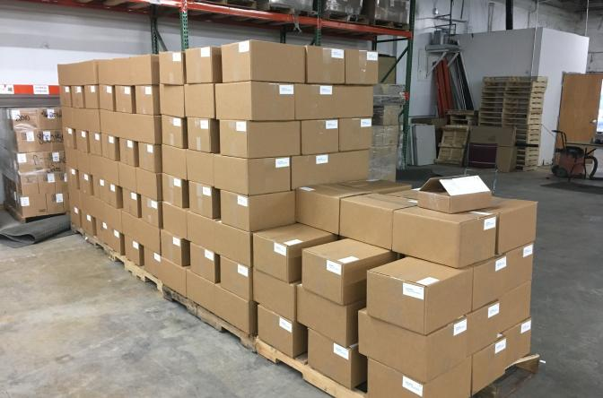 boxes piled up in warehouse